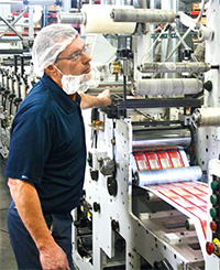 Press operators should wear hair nets, beard masks, and gloves when ­running food labels.