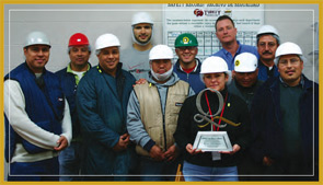 A group of employees from Michigan Turkey Producers pose with the Food Quality Award. The company believes that communication is key to ensuring that all employees are looking out for safety and quality; associates attend both weekly and monthly meetings with managers.