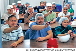 Food production workers train with the SISTEM platform.
