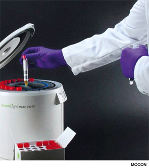 Placing a sample into an automated rapid microbiological tester.